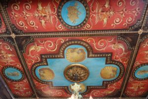 The library ceiling is one of the most beautiful sights in this house. It is another example of John's passionate work. John would sketch what he wanted, then create a stencil, and finish with the painting. Strips of trim were painted gold and used for the borders.