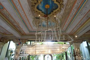 John's love for the sea inspired him to buy this 17th century crystal ship chandelier in Venice, Italy in the 1940s. I also admired the ceiling in this cypress room. The painting was done with stencils on top of real pecky cypress.