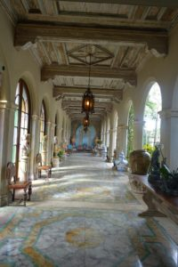 John and Bill's cloister, or covered walk, added by well-known Swiss-born architect, Maurice Fatio in 1928. The ceiling is pecky cypress, and the floor is poured cement, marbleized by John himself, and painted in trompe l'oeil.