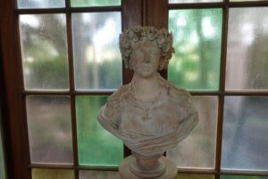 The cloister also includes several busts on pedestals, all brought back from John's various trips to Europe. This bust is made of terra-cotta.