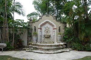 This fountain was designed by Fatio and embellished by John, who added the lanterns and other design elements.