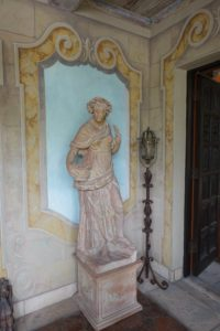 in another small loggia, John did the trompe l'oeil painting behind this statue from Italy.