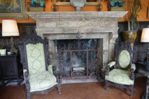 This beautiful fireplace is made from coquina, and is a 1928 original. The chairs are also original to the house.