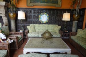 In the same room, beautiful linen fold paneling by Addison Mizner. The furniture is also original to the home.