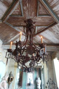 More gorgeous pecky cypress ceiling, and an interesting metal chandelier.