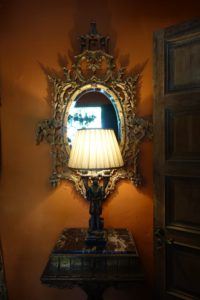 This mirror and lamp are also in the powder room.