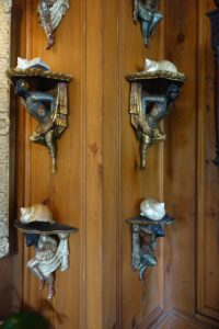 In what they call their morning room, Bill and John hung up these Blackamore nautilus shells.
