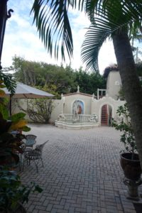 This is the back of the house. John added the fountain and the walkway next to it in the 1970s.