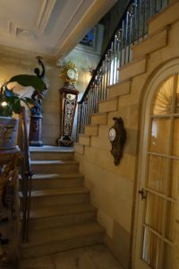 The stone stairwell leads up to the second floor of the 14,500 square foot home.