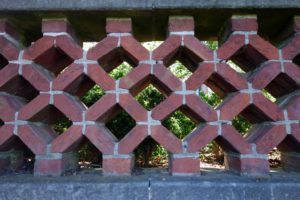 A wall in the Urn Terrace is topped off with this wonderful technique called pierced brick.  To create this lattice effect, the ends of the bricks were cut at 45º angles.