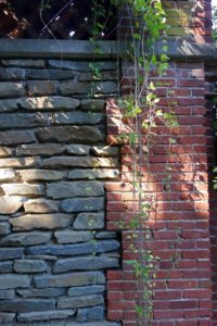 More great brick-work joining a stone wall.  I often photograph such amazing stonework in hopes of one day incorporating such designs in my own garden.