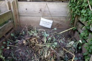 A compost area in the vegetable garden.