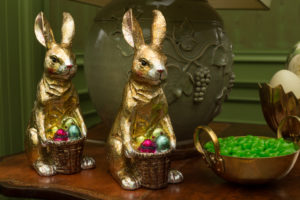 These look like old fashioned chocolate bunnies wrapped in foil, but they're really ceramic bunnies covered in foil. They may not be edible, but they will last much longer.