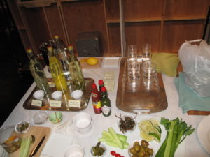 Various flavors of infused vodkas and the ingredients, for our Grown-Up Grilled Cheese and Bloody Mary segment.