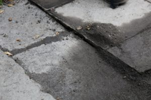 For some reason, the flagstone path at the Maple Avenue house sank in one area.