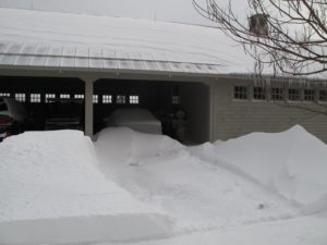 The snow made interesting ripple patterns on the metal roof of the carport.