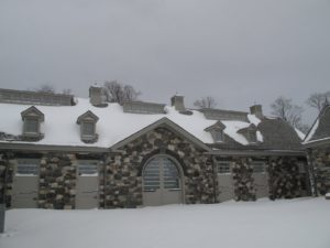 The stable courtyard was blanketed with considerable snow.