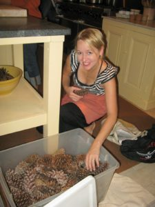Tamara Dilworth is busy with bins of pine cones.