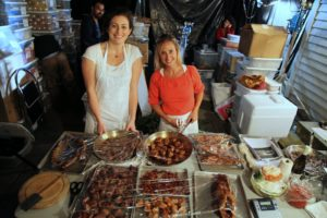 Nora Singely and Sarah Mastracco, TV chefs, prepare to move all the cassoulet ingredients onto the set.