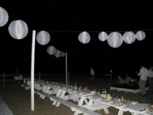 There were large illuminated Chinese lanterns hanging over the tables.