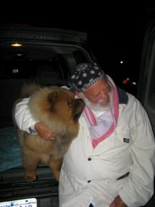 Bruce Weber loves dogs and he took time to nuzzle Ghenghis Khan.
