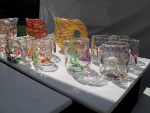 These beautiful hand blown glass pieces are by Tandem Glass Works. - http://www.tandemglass.com/