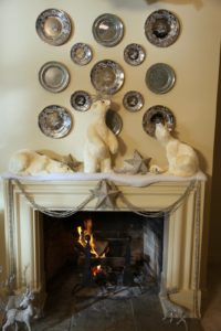 A great mantel decoration using those wonderful polar bears from the Martha Stewart line at Grandin Road - http://www.grandinroad.com/jump.jsp?itemType=CATEGORY&itemID=6397&path=1,2,474,6385%2C6397