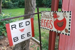 The signs at the entrance to Red Bee