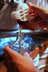 Honey is transferred from vat to bottle.