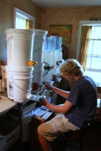 My nephew, Charlie, was busy bottling honey that day.
