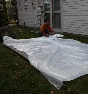 Chhiring and his crew covered all of the air conditioner intakes.  First, sheets of plastic were laid on top.