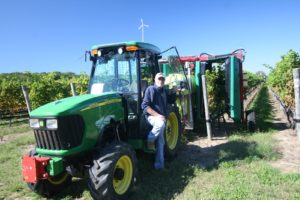 Emerging from the cab is vineyard manager, Charles Flatt.