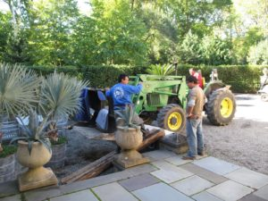 Meanwhile, at the sunken garden, the crew is moving more and more tropicals.