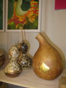 Ron King Gourd Vessels - http://www.rkinggourds.com/index.htm - are embellished gourd vessels.