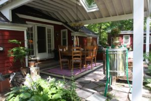 Because the cottage is small, this outdoor 'room' is a great place during warm weather.