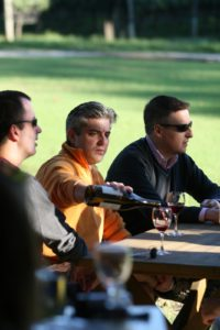 Outdoors, wine tasters enjoy the crisp autumn weather.