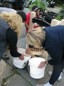 Swapping out buckets of cider