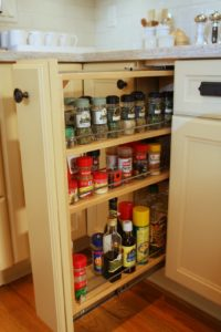 Nicole loves this slide-out spice rack.