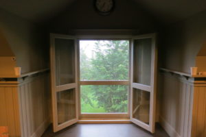 I like to open the windows for fresh air whenever possible.  This window looks onto the pear grove below.