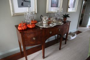 My Sheraton style sideboard decorated with bright orange ceramic pumpkins