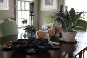 The dining room table with Mexican pottery bowls filled with Halloween candies