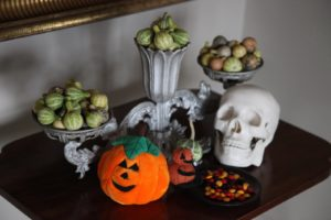 Unusual tiny gourds adorn this side table.