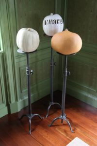 These plant stands are handy holders for pumpkins.