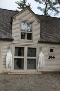 The gym building by the main gate is decorated with gauzy ghosts and silhouettes.