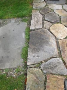 The stones along the edge of this patio need to be raised as they have settled over the years.