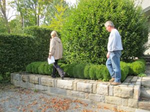 To reach the back of the house, we walk along this beautifully built stone wall.