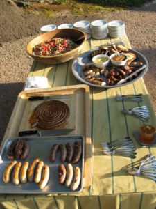 Flavorful grilled sausages were served at this table with mustards, grilled bread, and the bean salad.