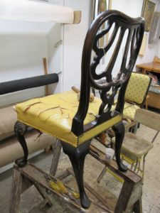 This yellow leather chair dates from the 18th century.
