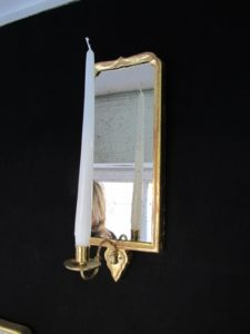 Reproduction mercury glass and hand finished brass hardware complete this handsome sconce.
