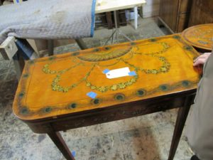 My eye was drawn to this lovely painted card table.  I was told that it is satinwood dating from 1890.